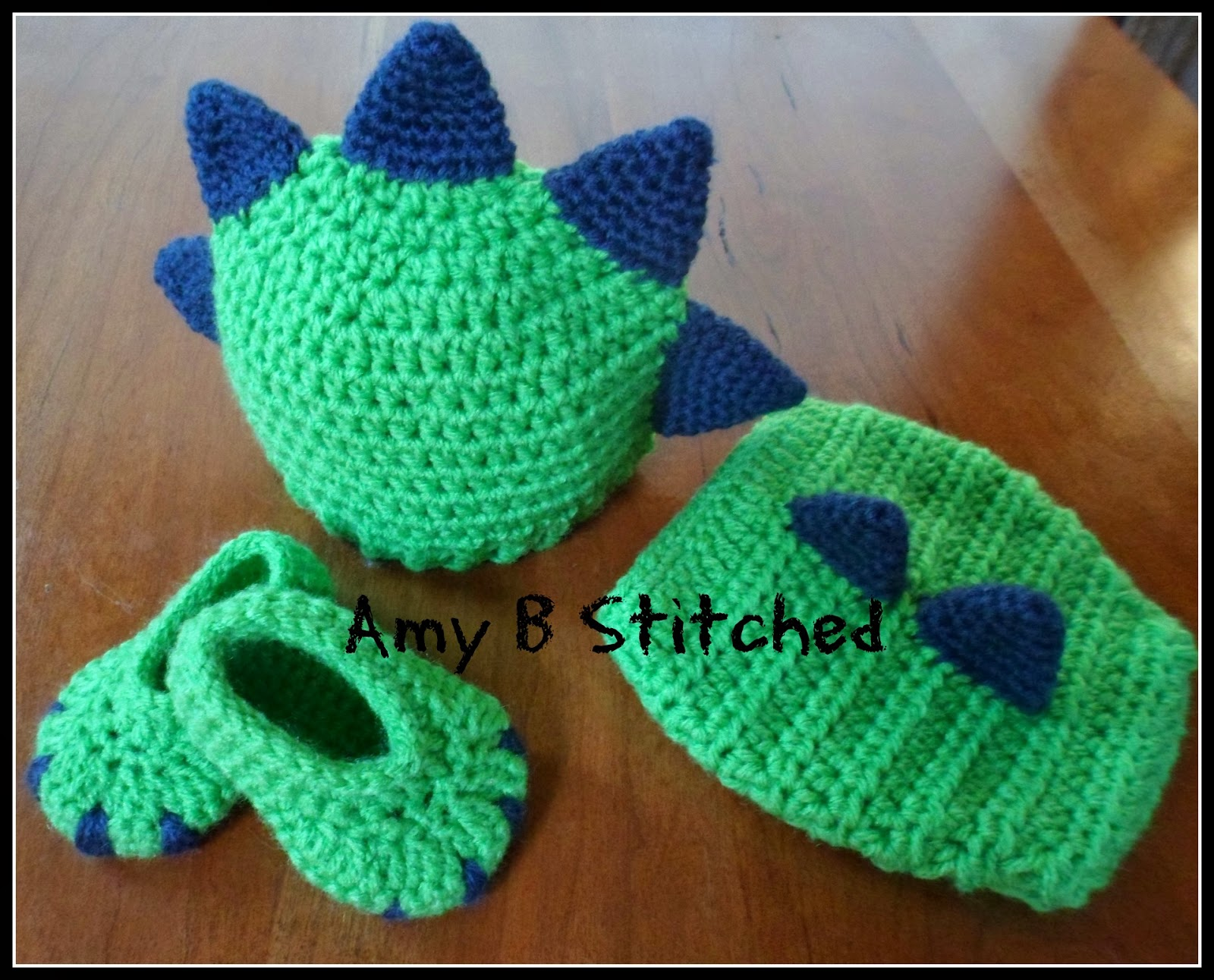 A stitch at a time for amy b stitched newborn dinosaur baby hat newborn dinosaur baby hat and diaper cover set and a pattern review for monsterdinosaur booties bankloansurffo Gallery
