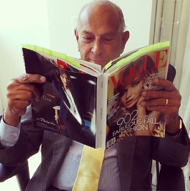 Fashion designer, Oscar de la Renta, reading his September Issue