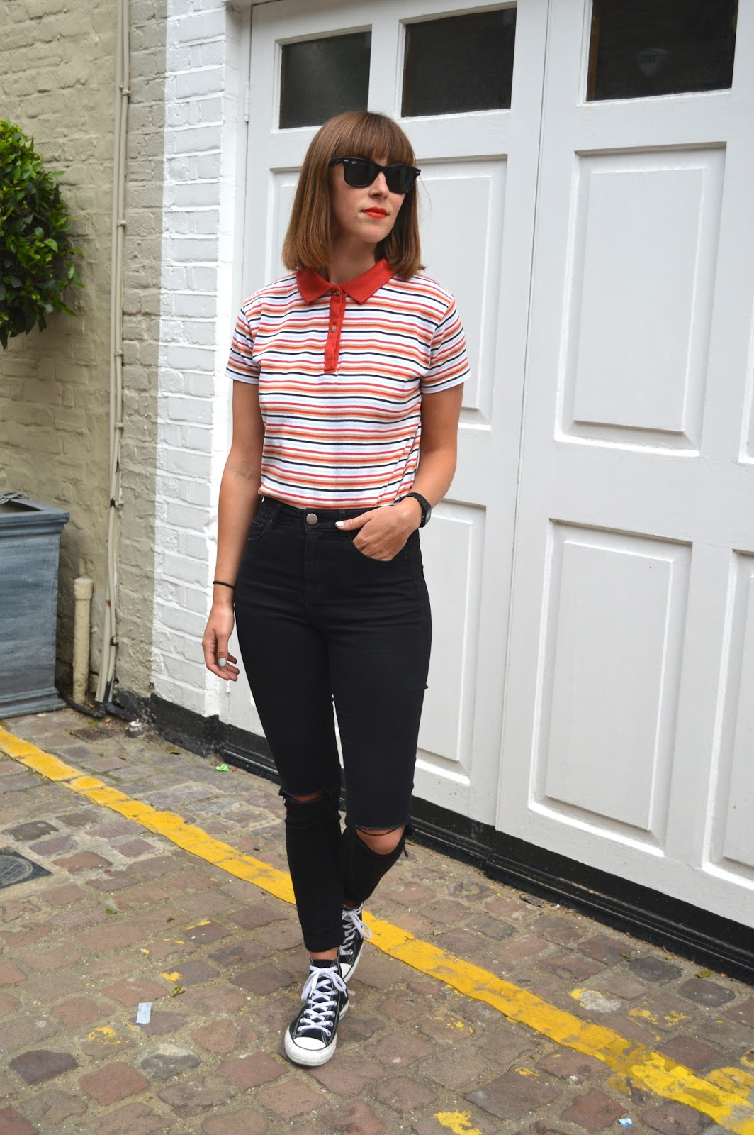 How to style a bright striped polo shirt with ASOs ripped jeans and Converse