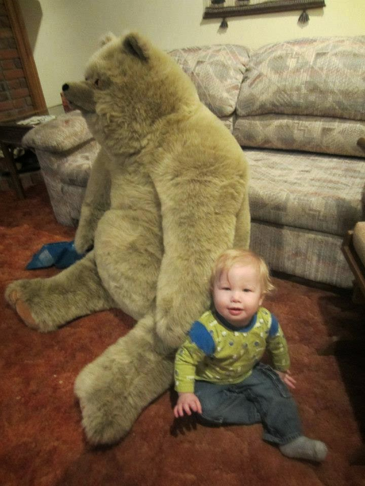 baby and giant stuffed teddy bear