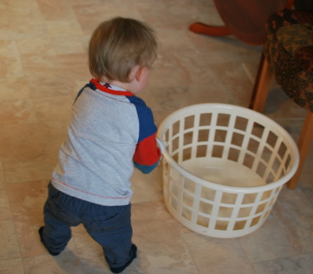 toddler feeding basket with his bottle