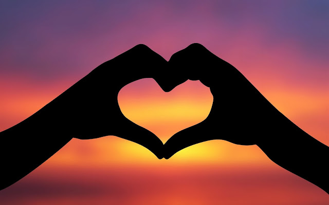 Achtergrond met een liefdes hartje gemaakt met de handen