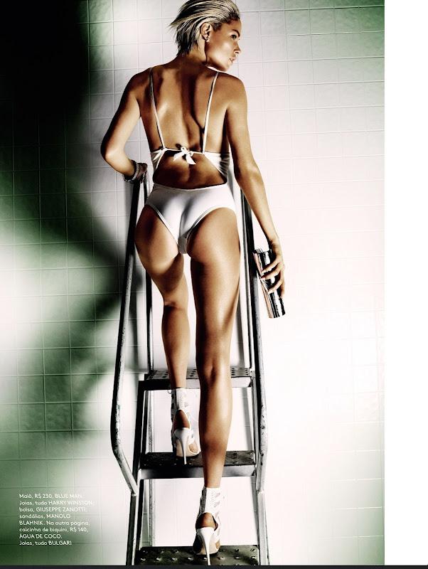 Doutzen Kroes hot in white bodysuit climbing up the ladder