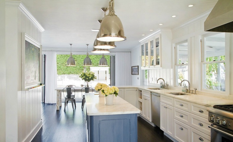 nautical kitchen with large silver lights, white cabinets and light washed blue island