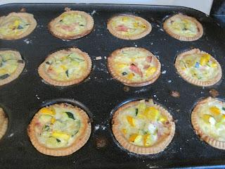 Zucchini mini-quiches in pan
