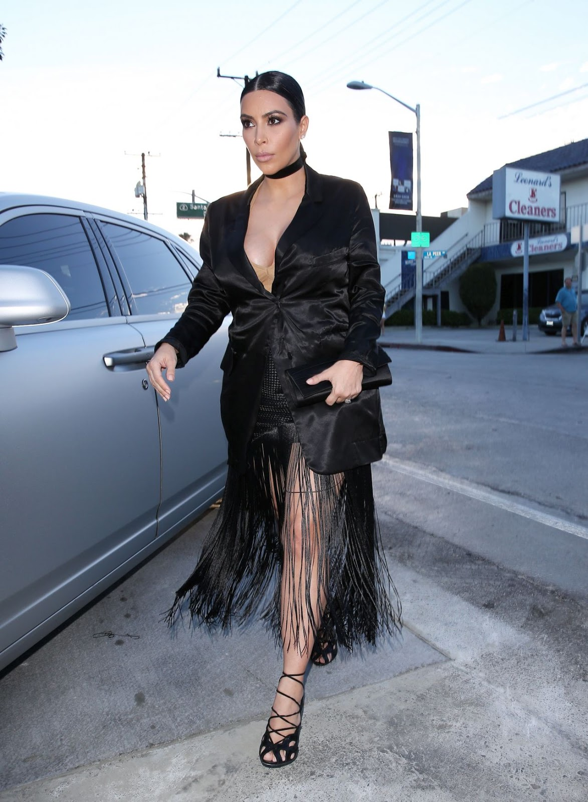 Kim Kardashian Camouflages Baby Bump In A Plunging Tuxedo