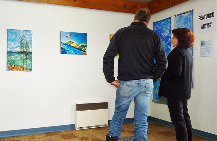 ArtSaturna Spring Show 2014 opening, viewing the work