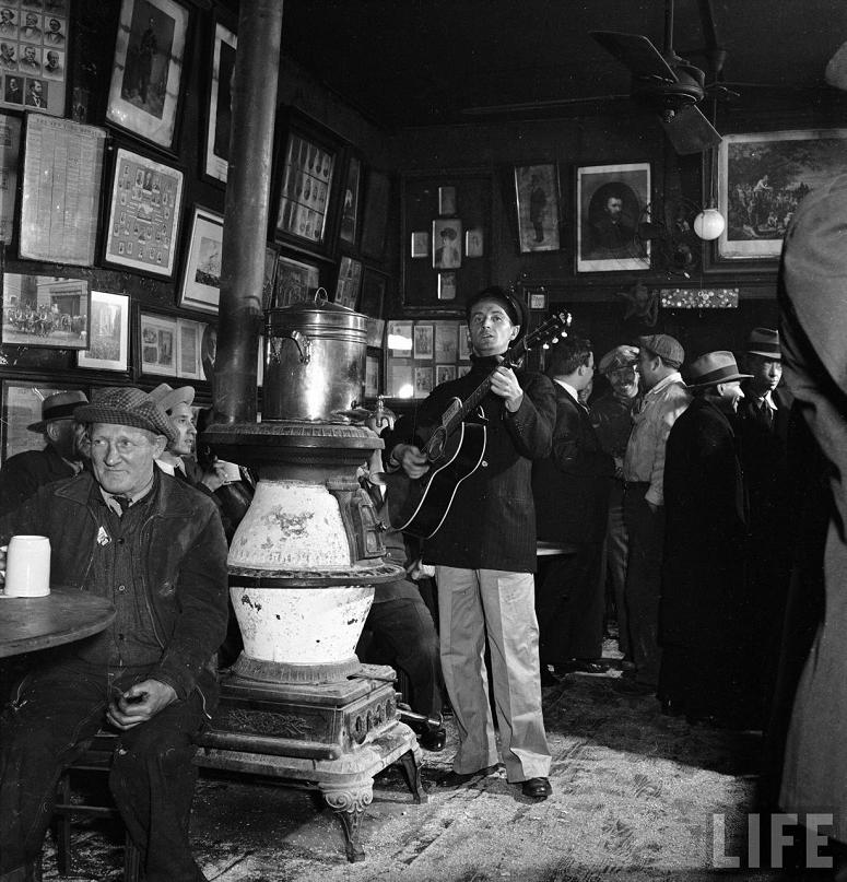 Woody Guthrie at McSorley's Pub, 1943 : Photo by Eric Schaal for Life Magazine