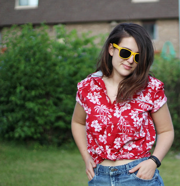 image of girl brunette girl in crop top with hawaiian shirt button up tied and high waisted jean shorts