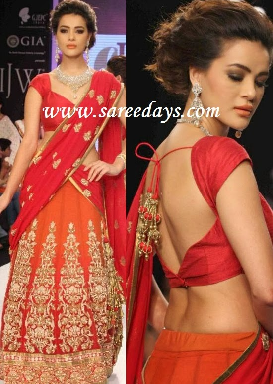 Latest saree designs red and orange lehenga style georgette checkout model displaying red and orange lehenga style georgette designer saree with gold work and gold heavy work on the lehenga and paired with matching altavistaventures Images