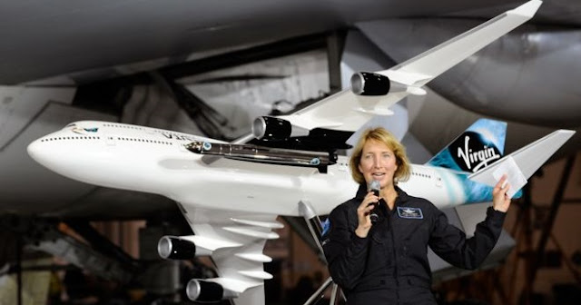 Virgin Galactic's newest pilot Kelly Latimer makes the announcement at an event in San Antonio, Texas. Credit: Virgin Galactic