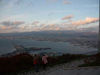 View of Hakodate and ocean from mount hakodate during sunset with steps of viewing area in foreground