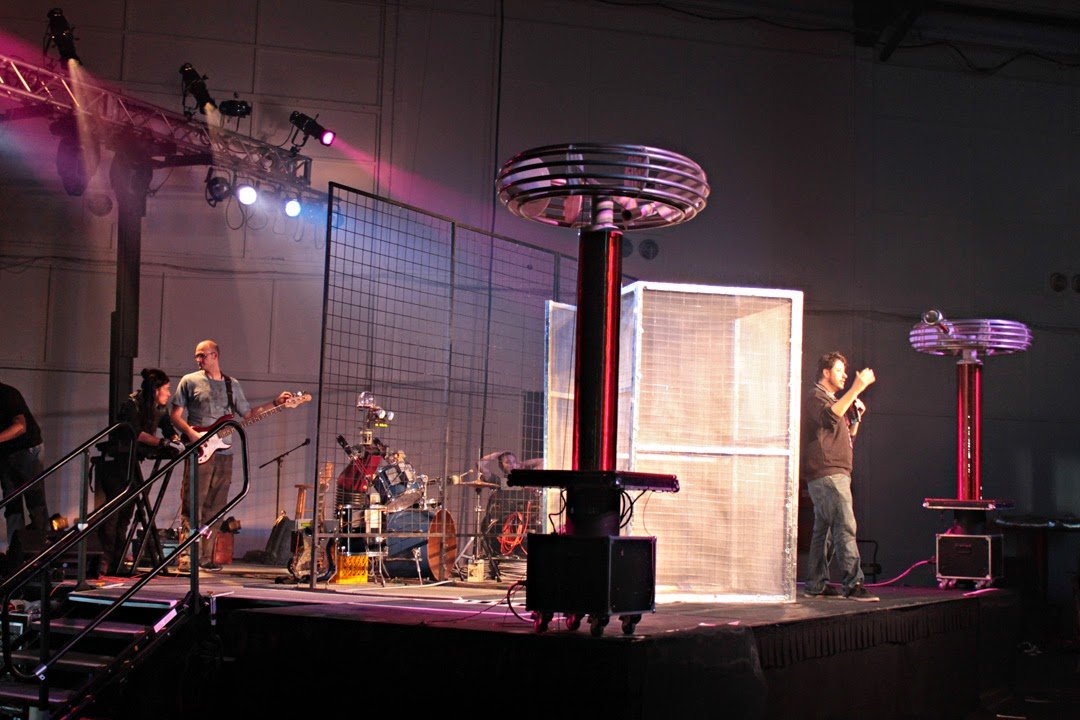 Emcee invites attendees to enter the cage
