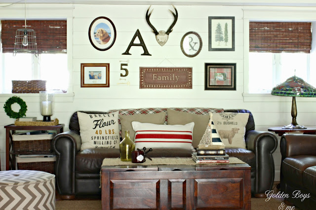 gallery wall on planked wall in family room-www.goldenboysandme.com