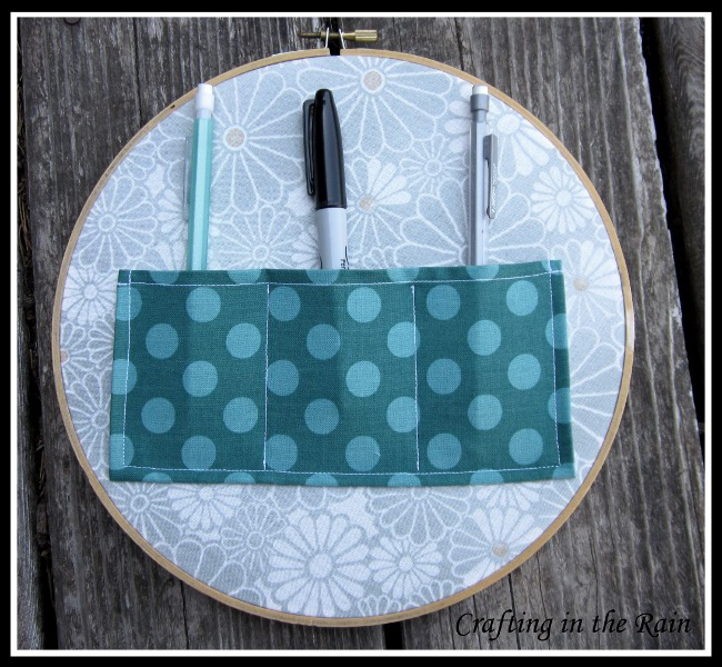 Embroidery hoop organizer crafting in the rain
