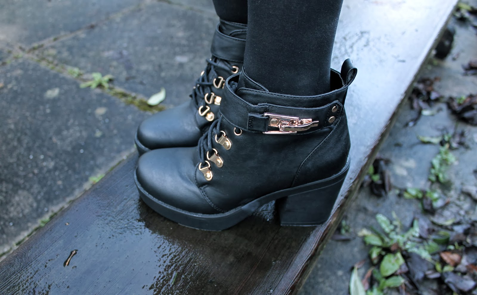 gold and black chunky boots