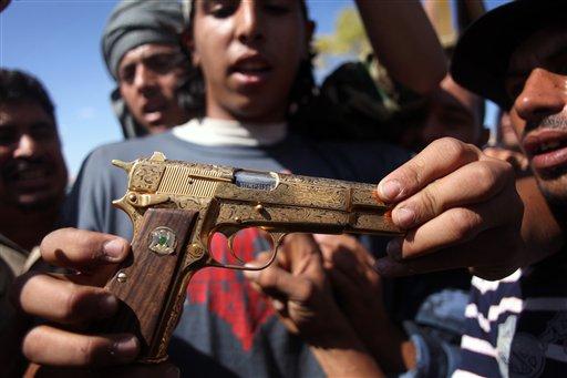 GADDAFI'S GOLDEN GUN, KILLED HIM?