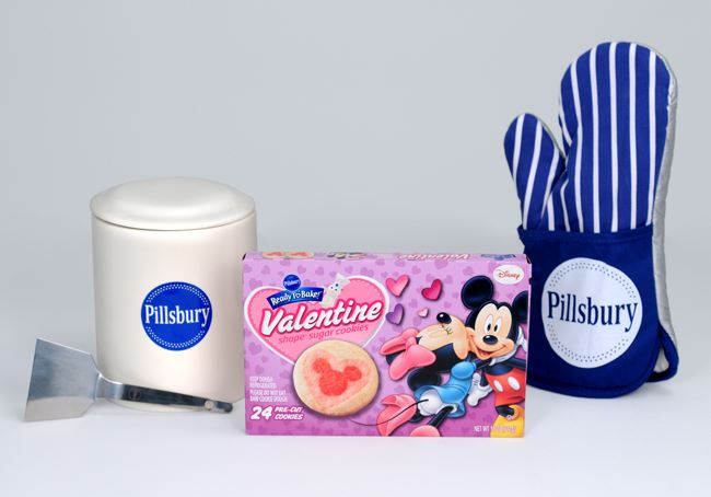 this giveaway will include all you see pictured an adorable little cookie spatula a cookie jar a vip coupon for a free box of pillsbury ready to bake