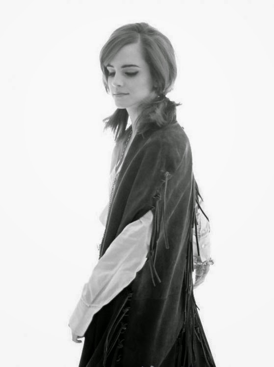 Emma Watson poses for a photoshoot for Elle 2014