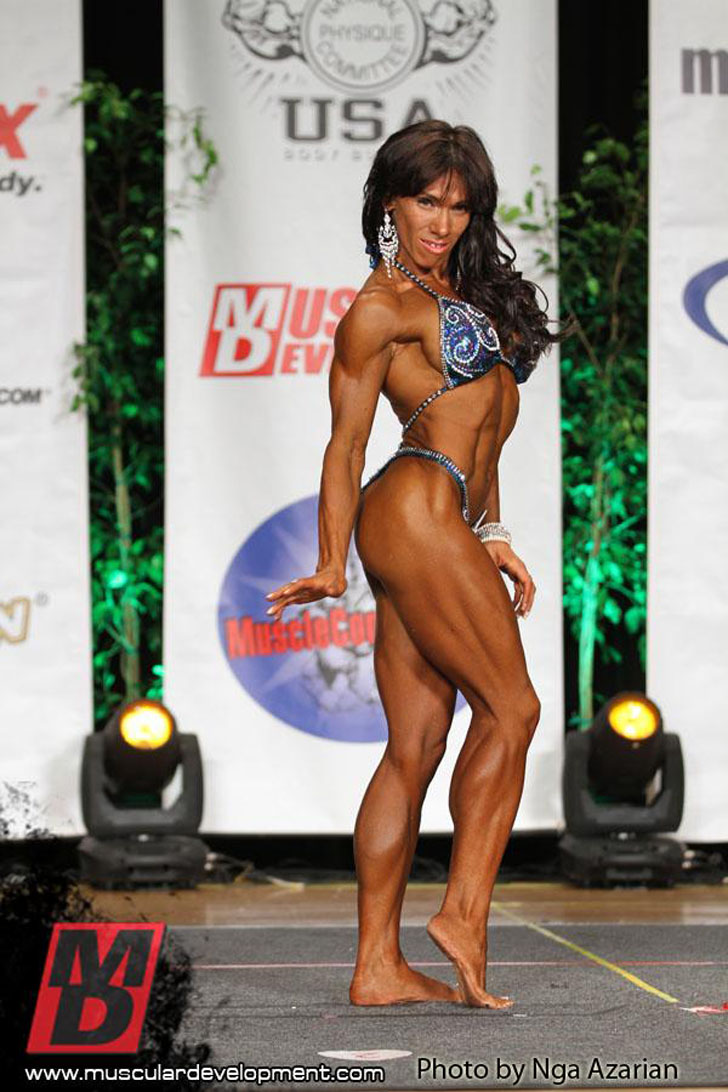 Venus Nguyen Flexing Her Muscles At the 2012 Titans Grand Prix