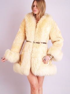 Vintage cream colored mongolian fur fluffy princess coat.