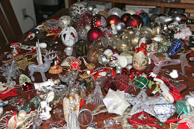 Christmas tree ornaments fill the table