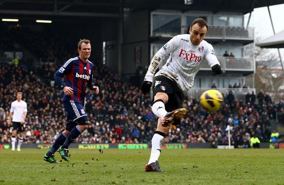 Fulham striker Dimitar Berbatov shoots and scores the winning goal against Stoke