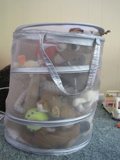 Stuffed toys in laundry basket