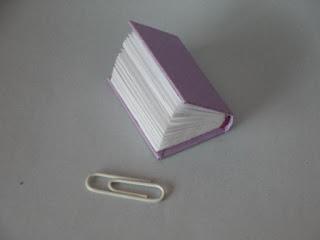 miniature hardbound book paper clip