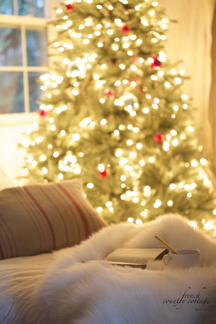Cottage Christmas Bedroom Twinkling tree and coffee and antique book on bed