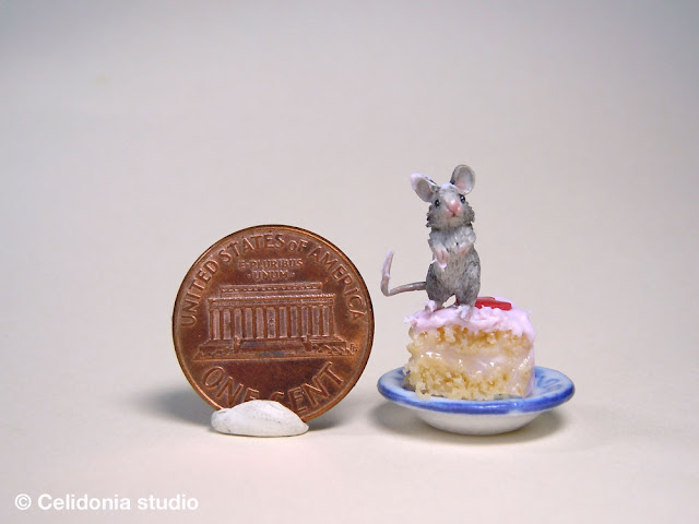 miniature mouse on cake