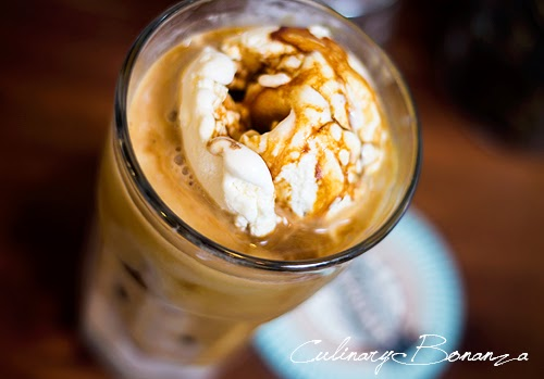 Fluffy Latte at Koultoura Coffee. a tall glass of straight latte (no sugar) topped with silky vanilla ice cream.