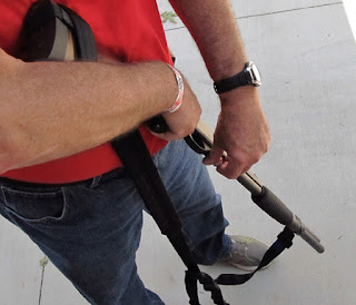 shooter is loading with left hand while reloading port faces to the right