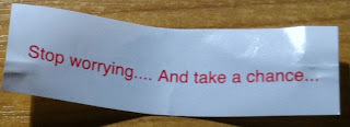 Fortune cookie slip saying, 'Stop worrying ... And take a chance'