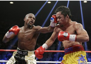 Mayweather and Manny Pacquiao fighting in the ring