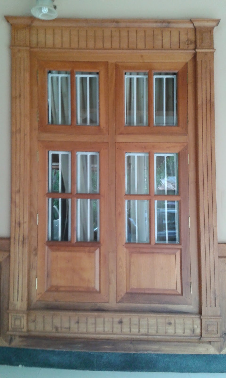 Kerala style carpenter works and designs may 2015 for Window frame design
