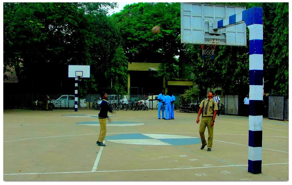 School boys practicing basket ball