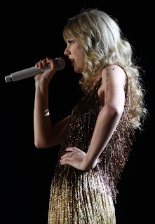 Taylor Swift Long Blonde Curly Hairstyle with Bangs