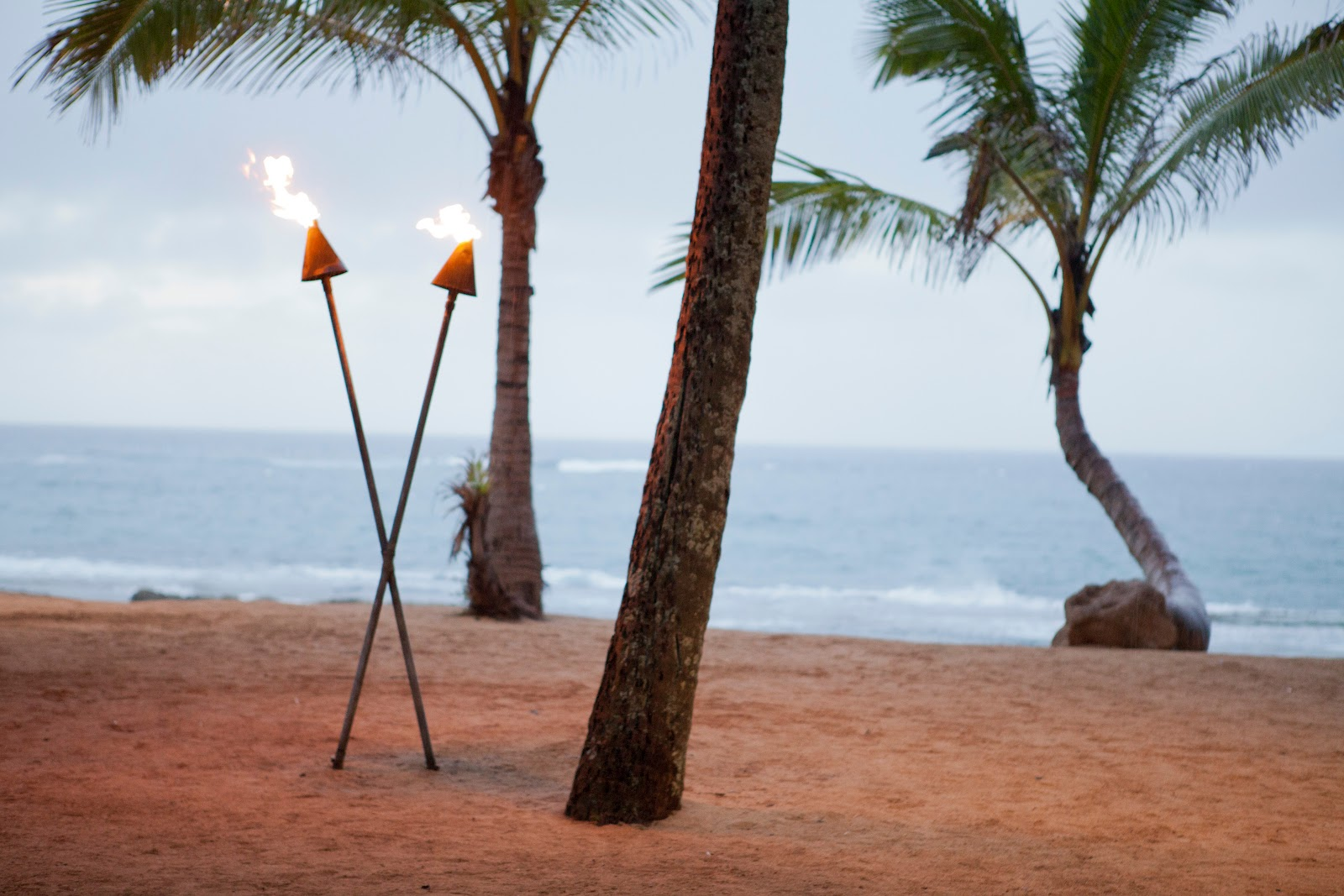 Tiki torches on the beach always offer a little romance.