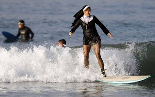Funny Picture,  nun on a surfboard