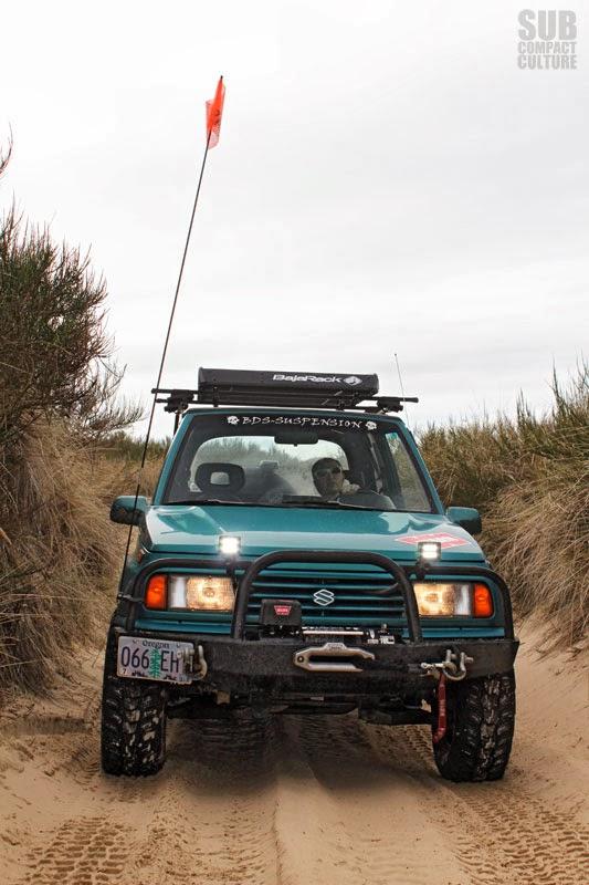 Sidekick on sandy trail