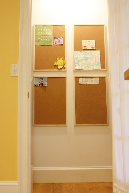 decorated corkboard grid in pantry