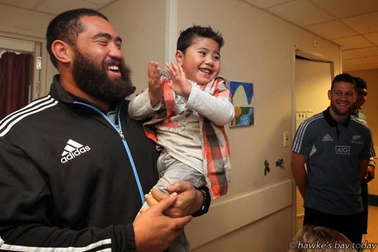 L-R: Charlie Faumuina, with Nathaniel Lama, Hastings - All Blacks visit the children's ward at Hawke's Bay Hospital, Hastings photograph