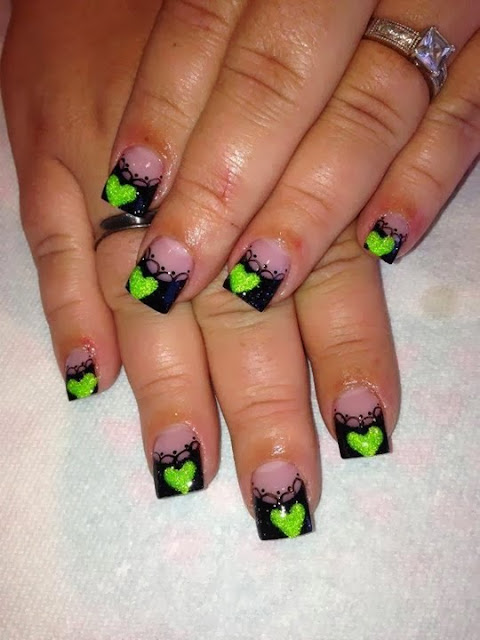 super super nail biter coming out bold in this acrylic sculpt in black glitz with hand painted black acrylic paint nail art and candy apple green custom glitz mix hearts nail art design