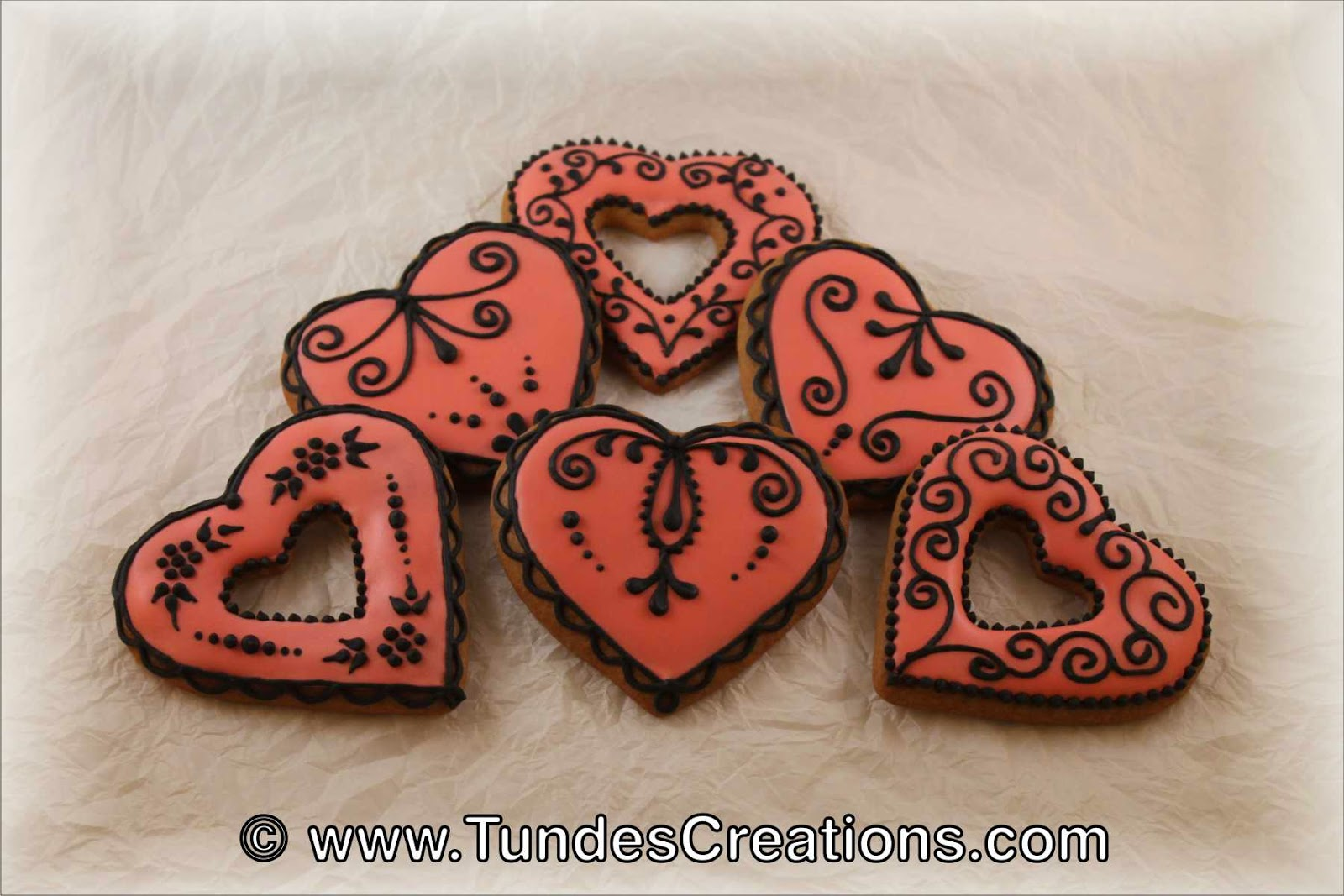 Pink and black traditional Valentine's gingerbread hearts.