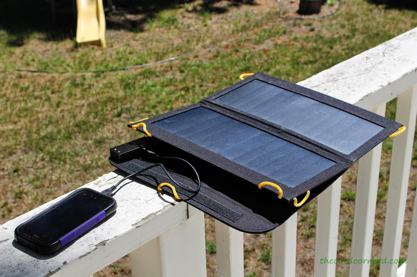 Levin Sol-Wing 13W Solar USB Charger: Charging a Phone on the Deck