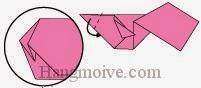 Bước 14: Gấp góc giấy vào trong giữa hai lớp giấy.