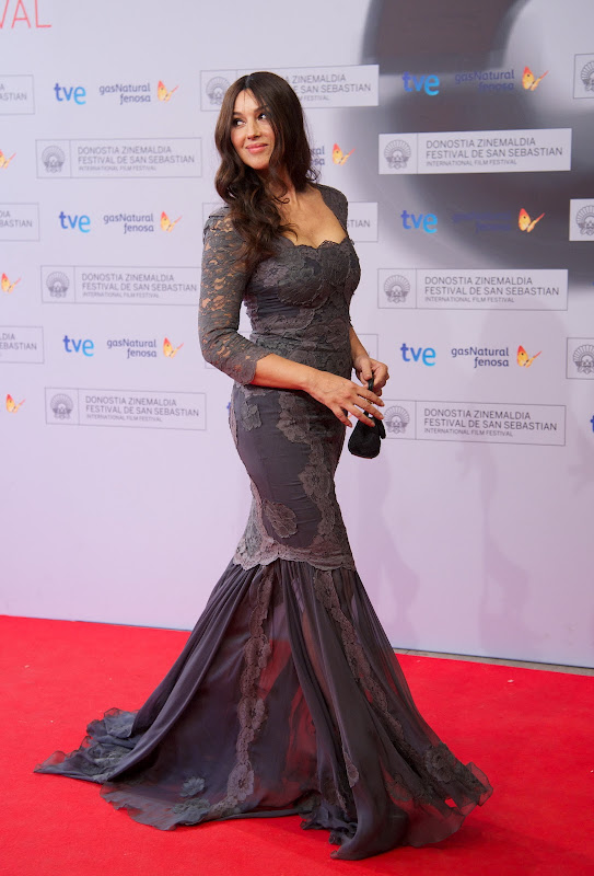 Monica Bellucci in a grey gown on the red carpet