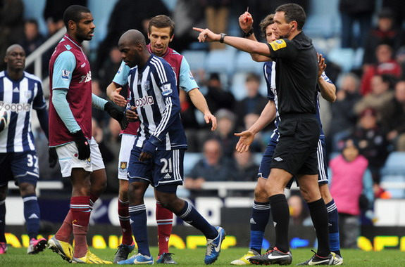 West Brom player Youssouf Mulumbu is sent off by the referee during a match against West Ham