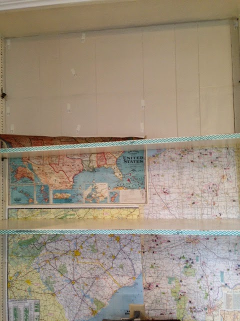 Taking down maps from shelves